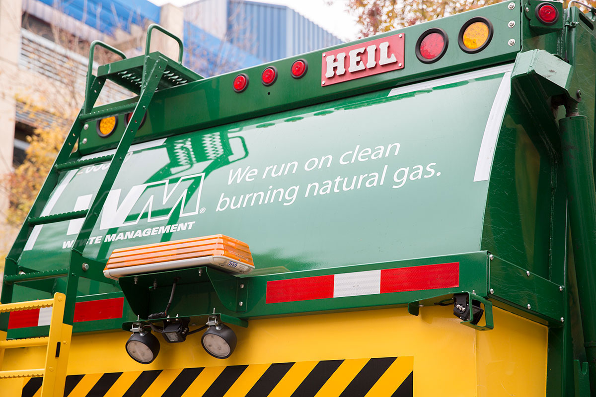 Back of Waste Management clean burning natural gas garbage truck