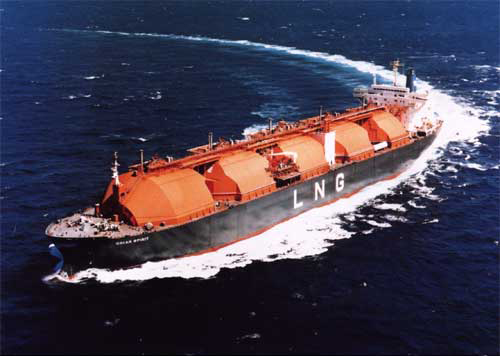 LNG Vessel at sea turning right from top left to bottom left of image