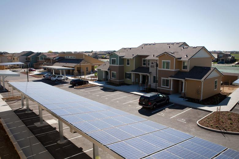 Housing complex with solar panel covered parking