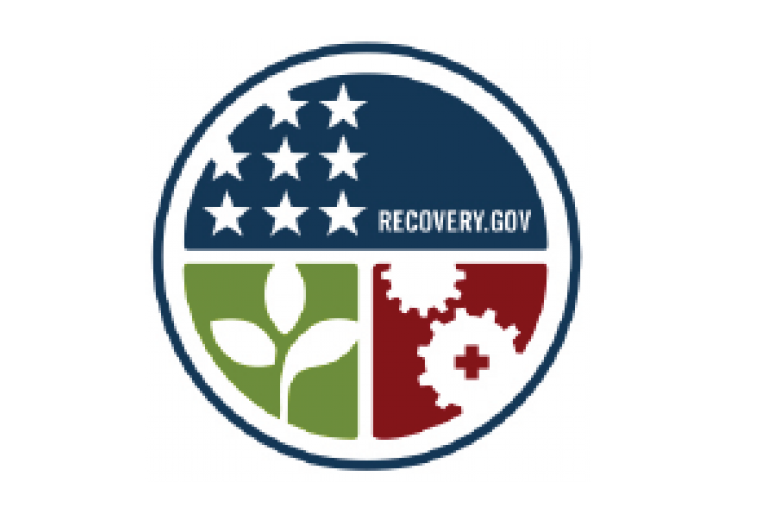 Pictograph signifying the American Recovery Act as a circle, top half stars and text, lower left quarter a plant and lower right cog and gears